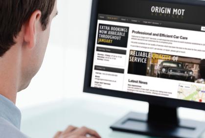 A man views the Origin GarageWeb page on a desktop PC